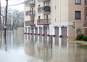 Flooded neighborhood in Queens NY covered by flood insurance
