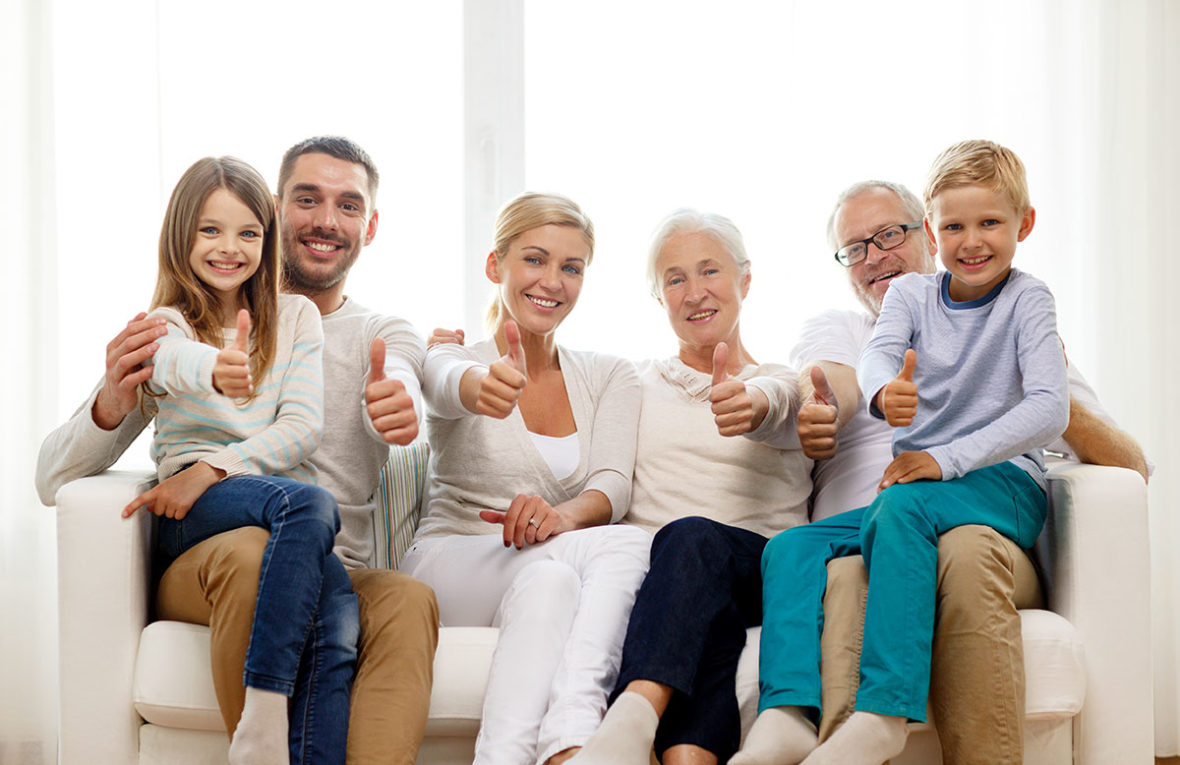 Family of homeowners giving the thumbs up in regards to their home insurance in Massapequa, NY