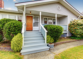 Home with stairs leading to front porch, protected by homeowners insurance in Amityville NY